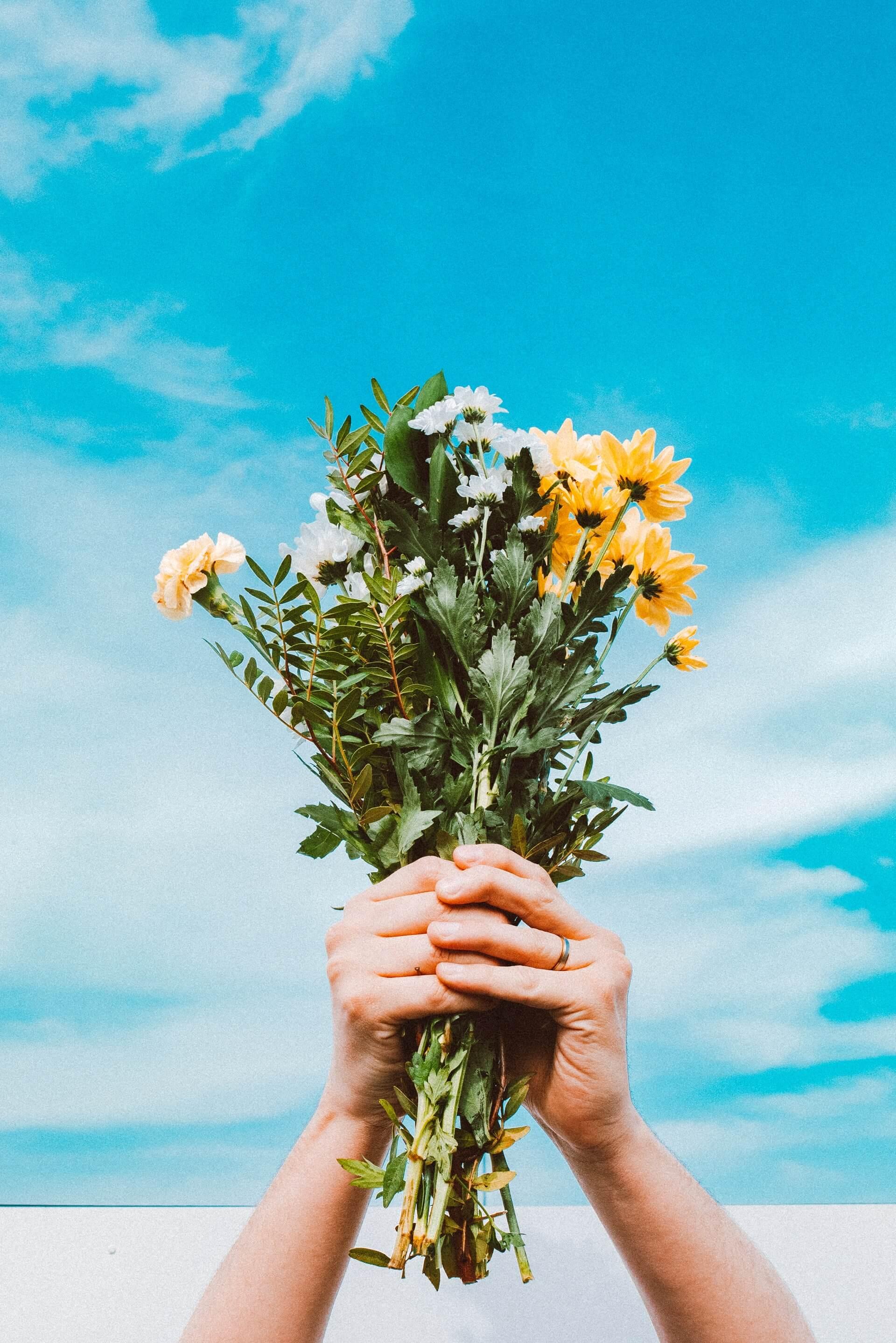 flowers being held